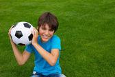 Boy holding football ball — Stock fotografie