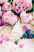 Key with pink peony flowers — Stock Photo