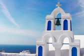 White with blue belfry, Santorini island, Greece — Stock Photo