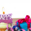 Cupcake with candle happy birthday and gift box — Stock Photo #47470353