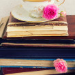 Pile of old books and mail with cup of tea — Stock Photo #47628333