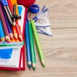 Books with school supply — Stockfoto