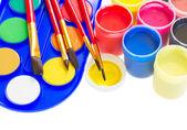 Kolorowe farby i pędzle — Zdjęcie stockowe