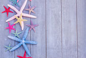 Starfish on wooden board — Stock Photo