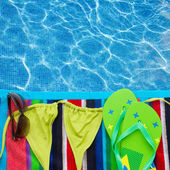 Sandals and swimming suit on towel — 图库照片