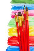 Brushes on paint spots — Stock Photo