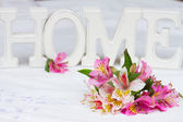 Alstroemeria flowers with home sign — Stock Photo