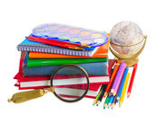 Books with school supply and globe — Stockfoto