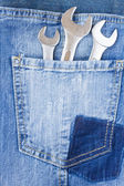 Set of spanners in jeans pocket — Stock Photo