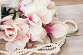 Magnolia flowers with pearls — Stock Photo
