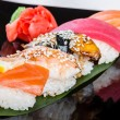 Five sushi on the bamboo leaf - Stock Photo