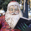 Santa Claus reading book — Stock Photo