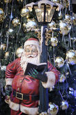 Santa Claus and a decorated Christmas tree — Stock Photo