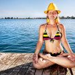 Stock Photo: Meditation in yellow hat
