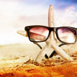 Stock Photo: Starfish with sunglass