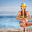 Yoga in yellow hat — Stock Photo