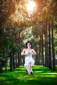 Yoga warrior pose in park — Stock Photo