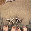 Royalty-Free Stock Photo: Legs and starfishes