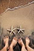 Legs and starfishes — Stock Photo