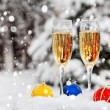 Stock Photo: Two glasses with champagne on snow