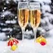 Two glasses with champagne on the snow — Stock Photo