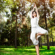 Yoga tree pose in the park — Foto Stock
