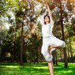 Yoga tree pose in the park — Stock Photo #17200841