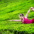 Yoga on tea plantations — Stock Photo