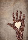 Coffee Hand holding cookie heart — Stock Photo