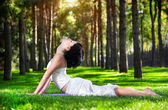 Yoga cobra pose in the park — Stock Photo