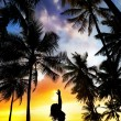 Royalty-Free Stock Photo: Yoga silhouette near palm trees