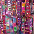 Foto Stock: Ethnic belts with mirrors