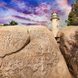 Lighthouse and carving rock in India — Stock Photo #25621095