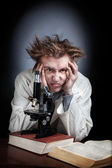 Scientist with microscope — Stock Photo