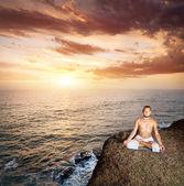 Yoga meditation near the ocean — Stock Photo