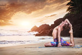 Yoga on beach — Stock Photo