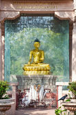 Golden Buddha in the park — Stock Photo