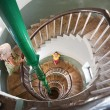Stock Photo: Womon Spiral stairs