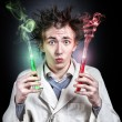 Crazy doctor with test tubes — Stock Photo #27697101