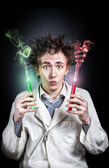 Crazy doctor with test tubes — Stock Photo