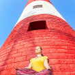 Meditation at lighthouse — Stock Photo #28576479