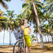 Woman with bicycle in nature — Stock Photo