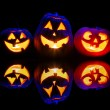 Halloween pumpkins glowing inside — Stock Photo