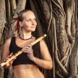 Woman with bamboo flute — Stock Photo
