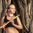 Woman with bamboo flute — Stock Photo #31353553