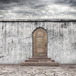 Stock Photo: Wall with door on dry earth