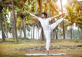 Yoga in tropical India — Stock Photo