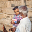 Indian man with little girl in India — Stock Photo