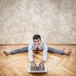 Indian man doing yoga with laptop — Stock Photo