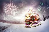 Christmas tree with fireworks — Stock Photo